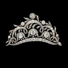 1184.An old cut diamond tiara/brooch, tot. app. 20 cts, mid 19th century. Silver, the drop shaped diamonds are app. 1.70-2.00 cts. Later broochpin in gold, tiara stand and box. L 9.5 cm. http://www.bukowskis.com/auctions/568/1184-diadem-brosch-runda-och-droppformade-antikslipade-diamanter-tot-ca-20-ct-1800-talets-mitt