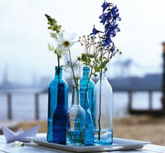 old colored bottles as vases
