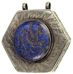 Persian necklace pendant :    Hexagonal Lapis Lazuli pendant, the original 19th Century silver setting surrounded by inscribed fishes. The pendant with a winged horse. Double loop to the top for wearing.  200 BC