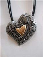 Beautiful heart shaped charm necklace. Comes with cord.