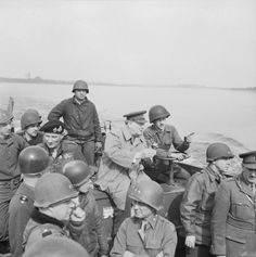 The Prime Minister Winston Churchill crosses the River Rhine to the east bank, south of Wesel, in an American Landing Craft Vehicle Personnel (or Higgins boat) with Field Marshal Sir Bernard Montgomery, Field Marshal Sir Alan Brooke and US General William Simpson on 25 March 1945.