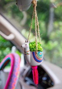 Does anyone need a mini critter succulent hanging from their rearview mirror? Nope. But should you? Yup! It's the perfect little addition to any car, desk or windowsill... any space that could use a little brightening up! Succulent and container combinations are sold as is. Hanging Succulents, Faux Succulents, Cute Car Accessories, 3d Prints, Cute Cars, Natural Life, Clay Crafts, Ceramic Art, Porcelain Ceramic