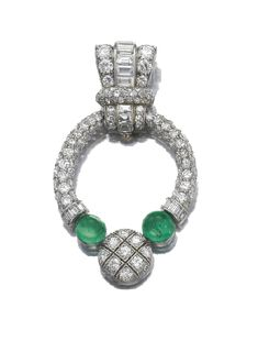Emerald and diamond brooch, Van Cleef & Arpels, circa 1928. Decorated with baguette, circular and single cut diamonds and emeralds cut en caboshon, signed Van Cleef & Arpels