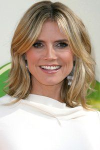 Heidi Klum's flicky ends and voluminous look works well with the on-trend centre-parting.