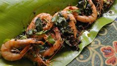 Butter prawns tossed with garlic cloves and black pepper.  http://www.straitstimes.com/breaking-news/lifestyle/story/escape-pulau-ubin-rustic-island-paradise-just-short-bumboat-ride-away- Photo: Dios Vincoy Jr for The Straits Times
