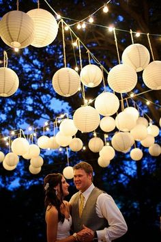Hanging paper lanterns for your outdoor wedding creates a dreamy atmosphere