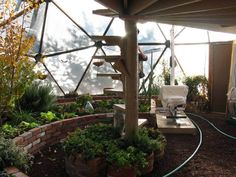 very cool looking greenhouse.  I love the 2 level and the bricks.