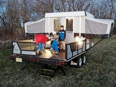 Camper Pod on a flatbed trailer. Pod is removable so you can use the trailer for other stuff when not camping. You could also load 2 bikes when you do go camping. Or a quad.