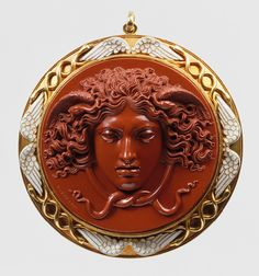 Head of Medusa, mid-19th century  Benedetto Pistrucci (Italian, 1783–1855)  England  Red jasper cameo, mounted in gold with white enamel by Carlo Giuliano