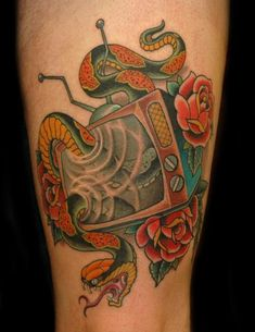 Tattoo Education : Tattoos : Russ Abbott : TV and Snake