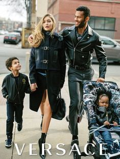 In another world—specifically the fashion editorial one—21-year-old Gigi Hadid is already the mother of two children. She and their father, a hunky male model, walk alongside them in the fall campaign for Versace.