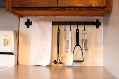 hang your cooking utensils rather than shove them all in a bucket on the counter... (more organizing ideas in this post too)