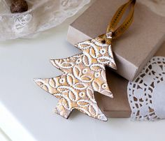 "Christmas Gift Tree decoration ornaments in white lace texture with gold varnish and gold thread.  made from cold clay with ""print"" technology and toned acrylic color and varnish antique gold.  The clay part measures:  Christmas tree - approx 4 x 3.5"""
