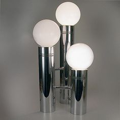 A handsome, well built 1970's chrome table lamp constructed of three joined cylinders. A trilight switch allows it the lighting of one, two or three bulbs. Image © Eclectisaurus. Visit our shop at 249 Gerrard St E, Toronto. 416-934-9009 www.eclectisaurus.com