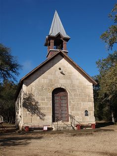 """Polly's Chapel near Bandera, Texas was built in 1882 by Jose Policarpo Rodriguez who was known as """"Polly"""".  He was a frontier scout for the U.S. Army, an Indian fighter, a hunter and a minister.  He joined the Methodist Church and was licensed as a Methodist preacher.  """"Polly"""" built this tiny chapel with his own hands."""
