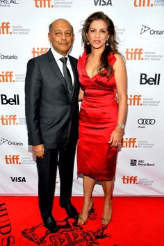 """Producer Anant Singh and Vanashree Singh walking the red carpet at the """"Mandela: Long Walk To Freedom"""" premiere during the 2013 Toronto International Film Festival at Roy Thomson Hall on September 7, 2013 in Toronto, Canada."""