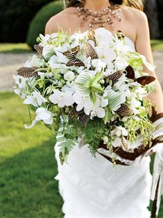 woman holding green and white flowers and brown and white butterflies