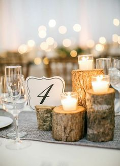 Logs aren't just for firewood anymore! This natural element adds a rustic and wonderfully wintry feel to your wedding décor.