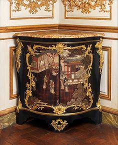 Corner cabinet (Encoignure), Maker: Bernard II van Risenburgh (ca. 1696–ca. 1767) Date: ca. 1745–49 Culture: French, Paris Medium: Oak veneered with ebony and Coromandel lacquer, cherry wood, and purplewood; gilt-bronze mounts; brocatelle marble top.