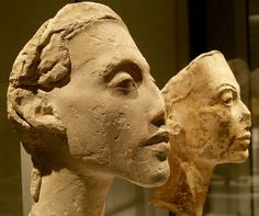 Eighteenth dynasty ancient Egyptian Pharaoh, Akhenaten. Reigned 1353–1336BC. Akhenaten is shown with his chief wife, Queen Nefertiti in these two damaged busts found in Amarna.