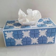 Perfect for decorating for the holidays and all winter long. Fits a standard size tissue box. Tissues not included.