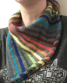Free Knitting Pattern for DaPunzel Scarf - Triangle shaped scarf with braided edge and stripes that are perfect to use up scrap yarn. Fingering yarn. Designed by Finja Hansen. Available in German and English, but the English is not always clear, so you might want to check the project notes of other knitters and the video she mentions.