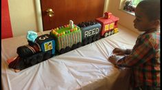 Train Cake.  My greatest achievement in cake decorating.  A birthday cake for my grand nephew's third birthday.  The equivalent of a full sheet cake.  Vanilla, banana, chocolate and strawberry cake with buttercream frosting.  (# best train cakes / train cake ideas / train cake pictures)