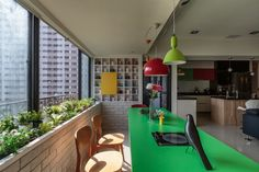 http://sandavy.com/inspiring-colorful-family-home-in-taiwan-inspiring-social-interaction-design/marvellous-dining-room-design-ideas-red-pendant-lamp-blue-navy-sofa-kitchen-design-ideas-colorful-family-home-ideas-green-dining-table-kitchen-island-kitchen-cabinet-glass-window-dining-chairs-green-p/