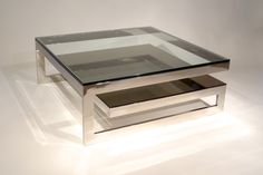 attractive glass coffee table with stainless steel table legs for luxury living room furniture idea
