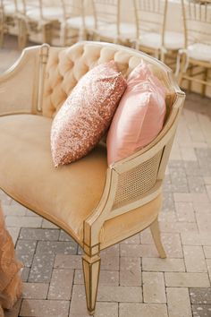 Beautiful vintage seating with sparkly pink pillows