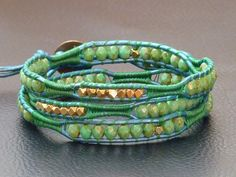 Moroccan Turquoise and Gold Wrap Bracelet on Metallic Peacock Leather