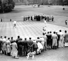 Gene Sarazen (right) putts out on the last hole of a 36-hole playoff to defeat Craig Wood (left) in the 1935 Masters. Sarazen's double eagle on the par-5 15th - the Shot Heard 'Round the World - gave the Masters its first major dramatic moment. It was the first tournament at Augusta National since the first and second nines were flipped. Some wonder whether the drama would have been the same had that hole still been No. 6. - - More photos and history at http://www.Augusta.com, #golf…