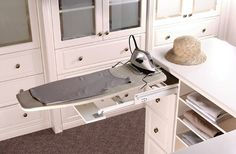 Pull out ironing board. Definitely need one of these.