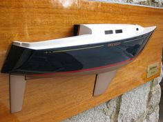 """* This is the 23.5"""" half hull model of the 1979 C&C 34.  The model is mounted on the Honduras Mahogany backboard. the size of the backboard is 30"""" x 12"""". The model weight is 11 LBS. ----   Please contact Mas at halfhull@gmail.com or visit the web at www.halfhull.net for more model information. Zuma Boat  (404) 272-7889."""