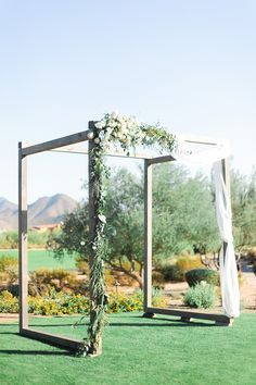 wedding ceremony arches - photo by Andrew Jade Photography http://ruffledblog.com/light-and-airy-garden-party-wedding