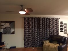 New drapes and painting to the left.