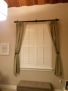 Extra high window in Plantation Shutter with divider controls and custom sill.