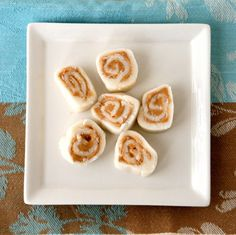 An old-fashioned candy with a surprising ingredient, these Potato Peanut Butter Pinwheels are a charming dessert. Coconut Candy, Peanut Butter Candy, Candy Recipes, Holiday Recipes, Dessert Recipes, Yummy Treats, Sweet Treats, Potato Candy, Sugar Dough