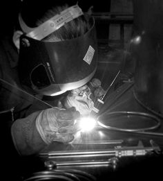Richard welding at The Forge workshop. Luxury bespoke metalwork by Garden Requisites.