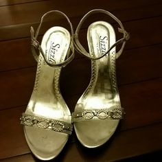 "SIZZLE special occasion heels SIZE 7 medium. These SILVER and faux rhinestone heels were worn once for a prom. There is one rhinestone missing from the back of the heel. Adjustable straps. 4"" heels. Usual scuffing from a fun night of wearing! SIZZLE Shoes Heels"