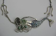 Scrollwork Designs  Mermaid pendant  soldering, silversmith work  interesting hair wire scrolls