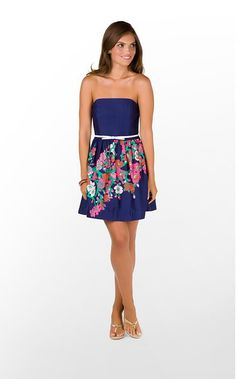 This cocktail dress is stunning with the floral pattern and little white belt.
