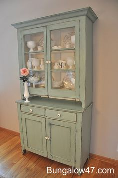 Is that milk glass I spy on the shelves? And the color is pretty too...