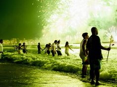 January 1 - 2013   [ People watching New Year's eve fireworks along Copacabana Beach in Rio de Janeiro. ]  Posted by #Randazdesign