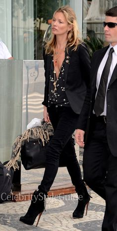 Seen on Celebrity Style Guide: Kate+Moss+wore+this+black+star+blouse+and+leopard+suede+booties+as+she+gets+her+family+in+the+car+as+the+leave+there+faction+in+Rio+De+Janerio+on+April+4,+2014+(+Photo:+AKM-GSI)+