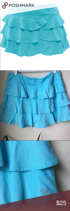 LIJA active wear tennis skirt Beautiful blue/turquoise tennis skirt 3 tiers of ruffles                             built in shorts for extra coverage. Never used no tags. Fits a medium/large. Lija Skirts Mini