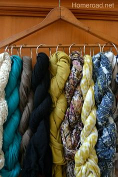 Twist scarves and loop them through big binder rings (or those good ole' shower rings) to keep them pretty and in place. With this trick, it only takes one hanger (okay, maybe two) to organize your collection.  Get the tutorial here.