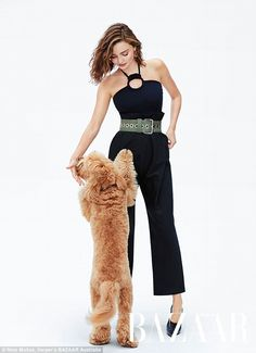 Furry cute! Miranda Kerr, 34, poses for a photo shoot with her beloved pet pup Teddy, as featured in the November issue of Australian Harper's BAZAAR