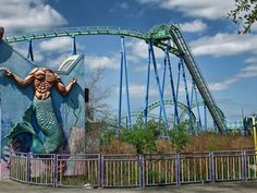 Headless merman and overgrown roller coaster at the abandoned Six Flags in New Orleans. Abandoned Theme Parks, Abandoned Amusement Parks, Abandoned Buildings, Abandoned Places, Six Flags New Orleans, Amusement Park Rides, Parcs, Ghost Towns, Around The Worlds