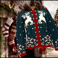 """Ralph Lauren Cardigan Christmas Reindeer Sweater Definitely not your Ugly Christmas sweater!   This Winter beauty by Ralph Lauren is Exclusive Hand Knit wool. Has zip front. Hunter green w/red and cream accents. Two front pockets. Playful Reindeer knit on both front and back. Collar is faux fur. Minor signs of age/wear some slight pilling, but overall good preowned condition. Measures 20-1/2"""" underarm to underarm. 24""""from collar seam to sweater hem. Sleeve length  23-1/2"""". Across Shoulders…"""